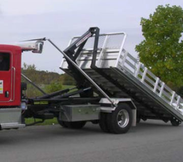 Hooklift AL95 Series, lifting capacity of 18,000 lbs. Enables loading from many positions; An hydraulic system. Deliver - Load - Dump.