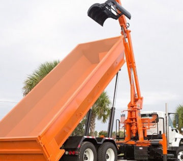 The model BL-3 is a 20 ft. knuckleboom loader that is permanently mounted in front of a roll-off.  You can use your existing roll-off boxes with this system.