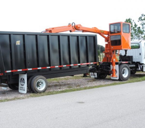 The Rear Mount Grapple Truck Model RL-3 from Petersen Industries is designed for loading into attached trailers or into separate haul trucks.
